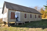 Buildings and structures: Jeff peeks in to a south shore cottage