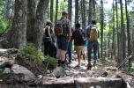 OCLP interns standing on a portion of new trail bed that has yet to be covered with dirt.